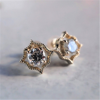 Diamond migraine earrings